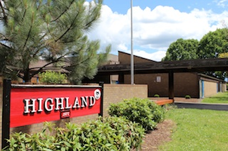 Highland Sign and front of building