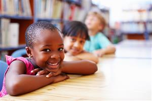 Image of smiling kids in class