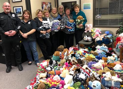 District staff and police officers in front of the blanket buddies